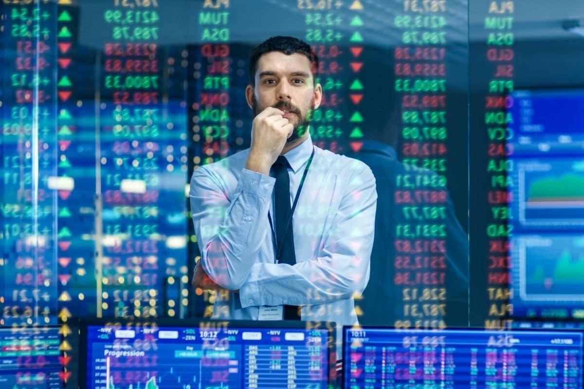 bourse et trading homme et graphiques